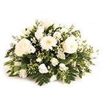 Bellissimo centrotavola di fiori misti bianchi per regalare dolcezza